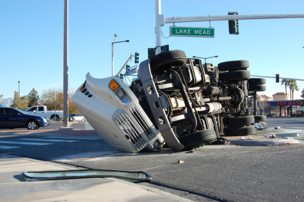 An overturned tractor-trailer in an intersection.